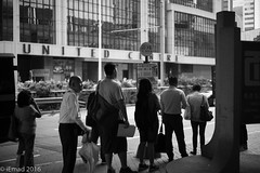 Life in Motion - The queue... (EHA73) Tags: summiluxm11450asph leica leicamm typ246 monochrome bw blackandwhite streetphotography hongkong travel busstop people crowd