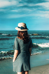 So far away (Phn Chua) Tags: girl sea cyan blue ssfoto pentax snor portrait picture photo photography film 55 dof depthoffield ocean clouds hat people woman red wind morning daylight daytime natural light vintage vietnam vietnamese lagi bokeh summer holiday
