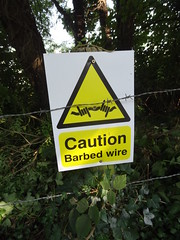 Why wasnt I told 60 years ago? (Yercombe) Tags: barbed wire sign