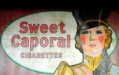 The Majorette (Poocher7) Tags: majorette drummajorette blonde girl blueeyes prettygirl iniform advertisement oldsign antiquesign sweetcaporal cigarettes ad old antique stratford ontario