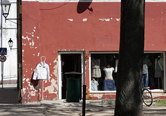 white jacket (kinaaction) Tags: wall city shop shopwindow urban urbanscenery sonyilce6000 secondhandshop summer shadow poland smalltown smalltownpoland