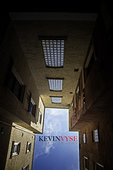 Urban Hole (Kevin Vyse Photography) Tags: city shadow sky ontario canada brick london up clouds buildings design nikon kevin looking view angle hole stuck image direction woodstock confined kvphotography