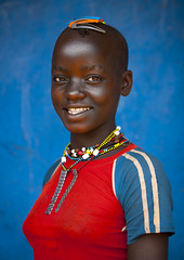 Bana girl at Dimeka, Ethiopia (Eric Lafforgue) Tags: africa red portrait people haircut color girl smile childhood vertical wall youth hair outside outdoors photography necklace kid day child young culture happiness tribal innocence omovalley tradition ethiopia tribe ethnic hairstyle oneperson confidence traditionalculture hornofafrica ethnology omo eastafrica toothysmile bluebackground traditionalclothing realpeople colorimage lookingatcamera coloredbackground waistup 8913 oneteenagegirlonly dimeka africanethnicity pastoralist snnpr onechildonly southernnationsnationalitiesandpeoplesregion hamerbenaworeda ethiopianethnicity oneteenager onekidonly onelittlegirlonly