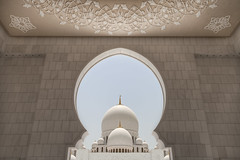 The Grand Mosque (Greg Annandale) Tags: travel white beautiful canon dubai arch framed minaret islam united uae mosque symmetry spire emirates zayed abudhabi arab dome frame stunning symmetrical archway ornate dhabi domes unitedarabemirates 1740 sheikhzayed grandmosque arabemirates sheikhzayedmosque canon5dmkii canon5dmk2