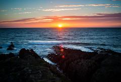 (drfugo) Tags: sunset sea england clouds rocks waves devon flare croyde saunton notquiteright canon5dmkii nikon55mmf12s nikkors55mmf12typeiv itotallyplannedthisinadvancetoo