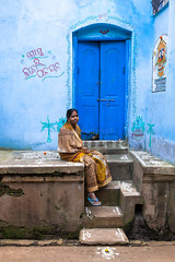 Blue, Puri (Marji Lang Photography) Tags: ocean life voyage door travel blue portrait people woman india color home colors girl azul stairs composition colorful sitting colours image god indian femme posing bleu frame sit porte colourful dailylife blau sari orissa indien bluedoor vie inde ordinary bluehouse puri jagannath oriya bayofbengal travelphotography indienne eastindia ef247028l handpaintings canoneos5dmarkii odisha travelanddocumentaryphotography marjilang