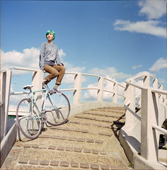 (333Bracket) Tags: bridge sky kite london 120 6x6 film girl bike clouds mediumformat happy high ride singlespeed vans hasselblad501cm fujixtra400 333bracket foffa planarcb80mmf28 ltmuseumcycling