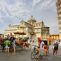 Getting around Pisa by horse or man power (Bn) Tags: world street camera city travel blue summer sky horses italy horse holiday green tower art heritage history classic tourism cemetery bike statue pose square fun photo site topf50 italia power carriage cathedral bell toren taxi famous capital snapshot descent landmark historic unesco falling pisa campanile tuscany restoration makeover mass rickshaw miracles iconic leaning pedicab cultural trishaw baptistery monumental piazzadeimiracoli piazzadelduomo campodeimiracoli freestanding 50faves scheve duomodipisa