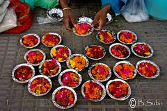 Flower seller...@ Haridwar,India.......IMG_4229 (subirbasak) Tags: woman india flower colour photography bucket asia pattern hand forsale basket display decoration craft vendor custom haridwar flowerseller artandcraft uttarakhand indiansubcontinent subirbasak gettyimagesindiaq4