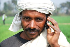 Farmer with his mobile phone in Bihar, India (CIMMYT) Tags: india man field mobile person persona site asia technology phone farm indian wheat telephone farming cellphone communication telfono celular campo farmer agriculture producer tic information partnership collaboration plot hombre mvil indio sitio trigo comunicacin granja informacin ict pusa southasia tecnologa bihar southasian asociacin agricultura labranza parcela agricultor bisa colaboracin productor cimmyt asiadelsur borlauginstituteforsouthasia institutoborlaugparaelsurdeasia