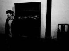 visitor in an ancient pawn shop (-{ ThusOriginal }-) Tags: 2009 bw blackandwhite china dark digital grd3 grdiii monochrome noir pawnshop people ricoh street thusihaveseen winter woman wuzhen