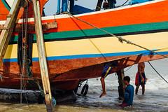 Climbing into Fishing Boat, Bancar Indonesia (AdamCohn) Tags: adamcohn indonesia tuban tubanregency boat fishing fishingboat kapal kapalnelayan ship shipsboats wwwadamcohncom bancar