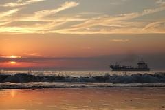 Trail (peeteninge) Tags: sea zee waves golven boat boot clouds sunset wolken zonsondergang beach strand holland outdoor