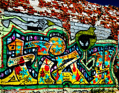 Actions Speak Louder Than Words (Steve Taylor (Photography)) Tags: ikarus action jungle babs eggs jroc bisg star bomb art digital graffiti mural streetart wall contrast scary eerie spooky crazy weird brick spray can aerosol paint newzealand nz southisland canterbury christchurch cbd city outline bug spiral