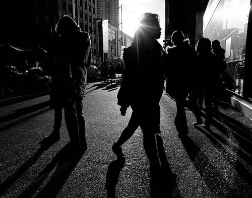 Bursting Onto the Scene Granville St, Vancouver BC   #streetphotography #blackandwhite #silhouette #againstthelight #againstthesun #shadows #downtown #vancouver #sony #nex5n #nex #apsc #highcontrast #highcontrastphotography