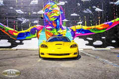 Monicas Vette with Rainbow Woman Mural in HDR Straight On Closeup copy (RoryMad Studios) Tags: hdr corvette chevrolet yellow murals shineproject shine stpetersburg florida
