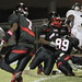 Northeast Linebacker Juvenson Julienand and Shawn Lawrence bring down Everglades QB Caleb Goldson