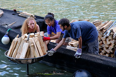Volunteers from Providence build fires on the Tiber River