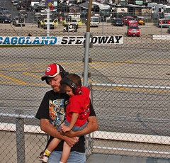 Protection (spincast1123) Tags: red summer people men racetrack race canon fence words illinois child pavement caps hats september equipment event nascar barrier trucks geico earmuffs protection joliet 2012 blacktop copywrite protected chicagolandspeedway hearingprotection 40d canon40d spincast1123 geico400 chaseforthechampinoship