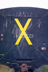 X on Back of Train (drewtrans8877) Tags: travel india sign yellow metal train warning back iron publictransportation traffic bright steel x case dirty dirt transportation letter vehicle alphabet backview southindia trafficsignals keralastate yellowx railtransport