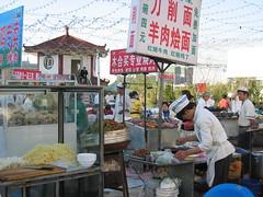 Street market in Urumqi, China (mbphillips) Tags: xinjiang 新疆 中国 west 中國 شىنجاڭ ürümqi 乌鲁木齐 ئۈرۈمچى fareast asia アジア 아시아 亚洲 亞洲 china 중국 mbphillips canonixus400 market 市場 市场 시장 mercado geotagged photojournalism photojournalist