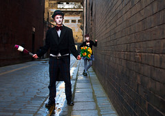 Clown Protection (csh 22) Tags: street flowers portrait wall 35mm glasgow clown streetphotography streetportrait backstreet brickwall streetperformer juggler clowns argylestreet newwynd glasgowstreetscene nikond90 glasgowstreetphotography