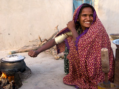 a women of thar in her kitchen, Sind (Tanwir Jogi) Tags: travel pakistan woman cooking kitchen girl beautiful smile trekking trek fire village cannon traveling tours lahore thar treks jogi g9 thardesert beautifulpakistan trekkinginpakistan traditionaldres cannong9 tanwir travelinginpakistan thetrekkerz tourisminpakistan tanwirjogi thariwoman