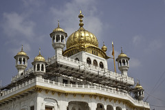 Scaffolding at upper levels of the Golden Temple (Ashish A) Tags: sky cloud india architecture clouds gold golden scaffolding minaret flag religion bluesky wires repair dome restoration sikh punjab amritsar sikhism goldentemple electricwires religioussymbol akaltakht cloudsinsky
