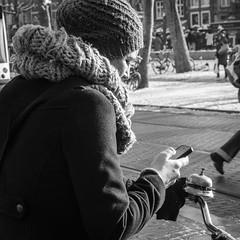 Amsterdam, Rembrandtplein (Bart van Dijk (...)) Tags: city urban bw woman netherlands monochrome amsterdam bicycle mobile blackwhite zwartwit sneeuw nederland citylife streetphotography squareformat bicyclist dailylife calling vrouw gsm stad mobiel fiets zw weer rembrandtplein bicyclebell fietser bellen stadsarchief fietsbel monochroom peopleinthecity straatfotografie peopleinthestreets straatnamen dagelijksleven mensenopstraat stadsleven peopleinamsterdam stadsarchiefamsterdam canoneos7d mensenindestad vierkantformaat 11format bartvandijk breeblebox menseninamsterdam cityarchivesamsterdam hotelfiestbelnl
