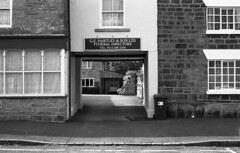 Easy passage... (Gabo Barreto) Tags: uk windows house film sign 35mm yorkshire leeds entrance fujifilm 135 englan thorner omsystem funeraldirectors