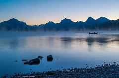 Memories of a quieter time (Photosuze) Tags: glaciernationalpark lakes sunsets lakemacdonald montana rocks water mountains sky
