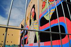 igualdad (Aiils) Tags: madrid lavapies espana spagna murales wall street art woman donna uguaglianza diritti sky blue colors canon eos 1100d travel trip summer sun light outdoor sbarre artist writer behind