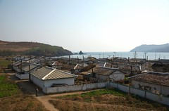 Coast village near Chongjin (Frhtau) Tags: dprk north korea korean people leute scene daily life asia asian east nordkorea scenery   choxin  outdoor      core du nord coreia do coria    culture landstrase landschaft feld children enfant kids play kinder village tumangang border einfarbig architektur gebude