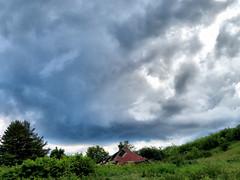 Abandoned Building (duaneschermerhorn) Tags: abandoned building roof decay clouds storm stormclouds sky blue green