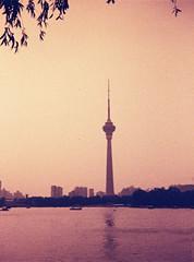 Television Tower from Yuyuantan Park (Matthew Huntbach) Tags: lomographylobster redscale yuyuantan beijing 110format halina110 televisiontower lake