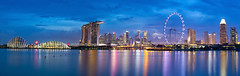 Singapore Skyline Panorama (baddoguy) Tags: architecture blue business businessfinanceandindustry capitalcities city cityscape colorimage crosssection design downtowndistrict dusk economy famousplace ferriswheel finance financeandeconomy gardensbythebay globemanmadeobject highsection horizontal landscape large marinabay marinabaysands modern nopeople outdoors panoramic photography reflection singapore singaporeflyer sky skyscraper smooth southeastasia travel traveldestinations twilight urbanskyline water watersurface