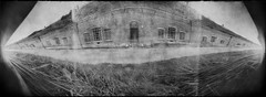 The Seventh Fort (batuda) Tags: pinhole obscura stenope lochkamera analog analogue can elliptical paper kodak polymax tetenal ultrafin 130 wide wideangle lowangle 180degree 180 building architecture brick fort fortification 7thfort seventhfort military ground grass sky window door underground casemats kaunas lithuania lietuva bw