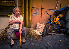 (Rob-Shanghai) Tags: china street portrait old lady people leicaq leica sitting brush bike tricycle seat pipes