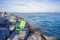 Green Chair on Rocks at Bosphorus Bank (danliecheng) Tags: bosphorus istanbul turkey bank chair coast culture dive editorial empty fishing green lifestyle people relaxation rest rocks sea sky summer sunbathe travel visit