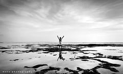 I feel free (memet metz) Tags: sky bw bali beach stone kids blackwhite feel free batu pantai putih hitam ombak canggu baliphotographer pererenan metzphotography