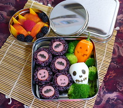 Creepy Egg Skull and Rolls Bento (sherimiya ) Tags: school halloween face sushi pumpkin lunch pepper skull kid healthy stainlesssteel rice jackolantern sheri egg peach broccoli spooky delicious homemade cube raspberry roll bento blackberries bats nori obento dipper quailegg turkeydog wholesomelunchbox sherimiya ecolunchbox