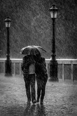 Hard rain (Enzo D.) Tags: blackandwhite italy rome rain umbrella walking photography photo couple streetlamps picture streetphotography cobblestones pioggia lampioni sampietrini biancoenero lazio ombrello hardrain romaromeitaliaitalywwwenzodemartinocom