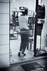 through the door (bryan-roos) Tags: china door leica woman window blackwhite shanghai pants class heels shorthair 中国 上海 clothingshop bryanroos bryanroosimaging