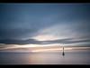 A Shimmering Glow (A-D-Jones) Tags: ocean blue sea sun seascape reflection beach water misty set clouds liverpool long exposure post marker beacon mersey crosby merseyside blundellsands