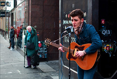 Street Performer ... prime pitch, Buchanan Street (CSHamilton) Tags: street people musician 35mm colours guitar glasgow candid january streetportrait buchananstreet busker busking minstrel shoppers guitarplayer candidportrait characterstudy peopleinthecity glasgowstreetscene nikond90 glasgowstreetphotography
