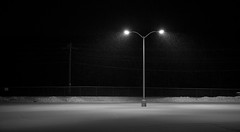 Empty Parking Lot (ShawnAlan) Tags: street light white snow black blur night fence solitude alone darkness personal space massachusetts parking creative tracks lot free commons tire pole falling negative use worcester massachustts