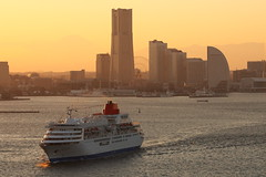 The Golden Hour (Teruhide Tomori) Tags: voyage cruise sunset sea building japan architecture skyscraper port landscape harbor construction ship cityscape  yokohama minatomirai    yokohamalandmarktower   fujimaru