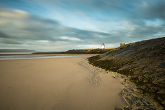 Burry Port (movinonagroove) Tags: lighthouse sunrise burry port harbour beach burryport southwales wales carmarthenshire clouds leefilter lee seadefences channel water sea thegower nikon