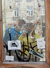 The Tourists and their Selfie (Antropoturista) Tags: poland krakau krakow reflection selfie nino ego stickers graffiti streetart couple tourists mirror cat