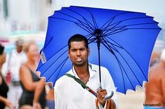 seller (tomasnot) Tags: gargano puglia mare sea sand spiaggia summer ombrello umbrella seller